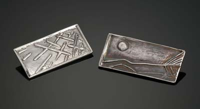Carved metal clay brooches
