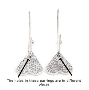 Earrings with badly placed holes